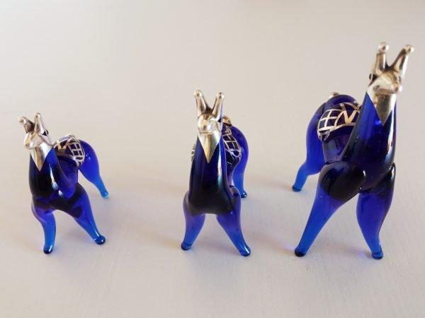 Trio of silver alpaca figurines